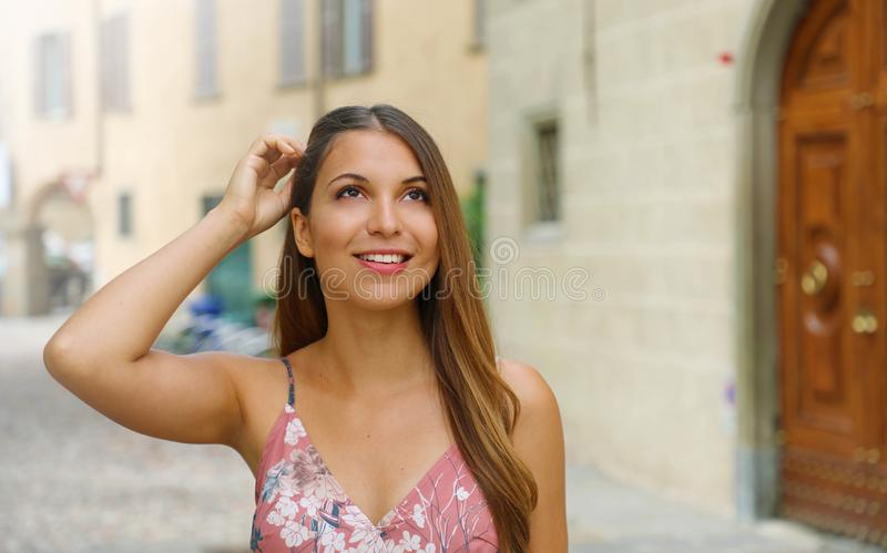 Portrait of young woman walking in beautiful old Italian city street stock photography