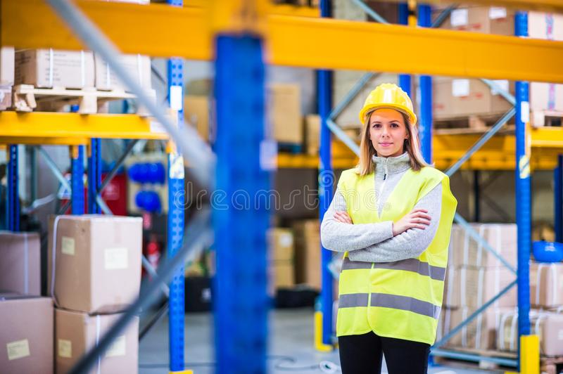 Portrait of a young woman warehouse worker. stock photo