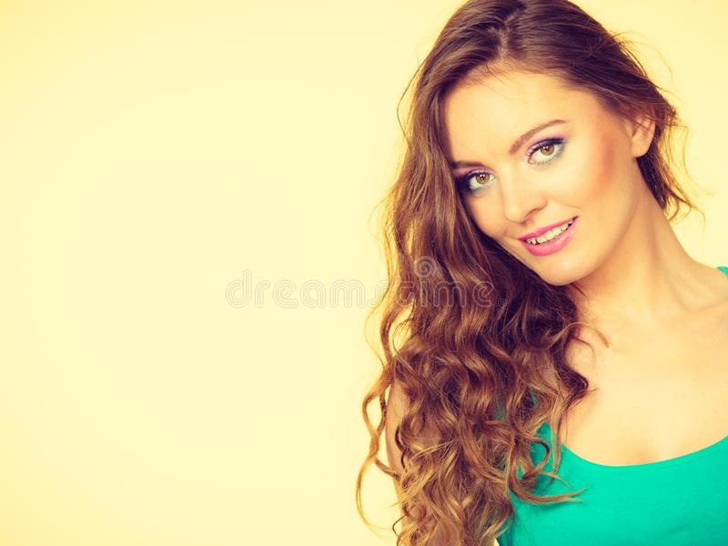 Portrait, young woman wearing colorful makeup and blue top stock photo