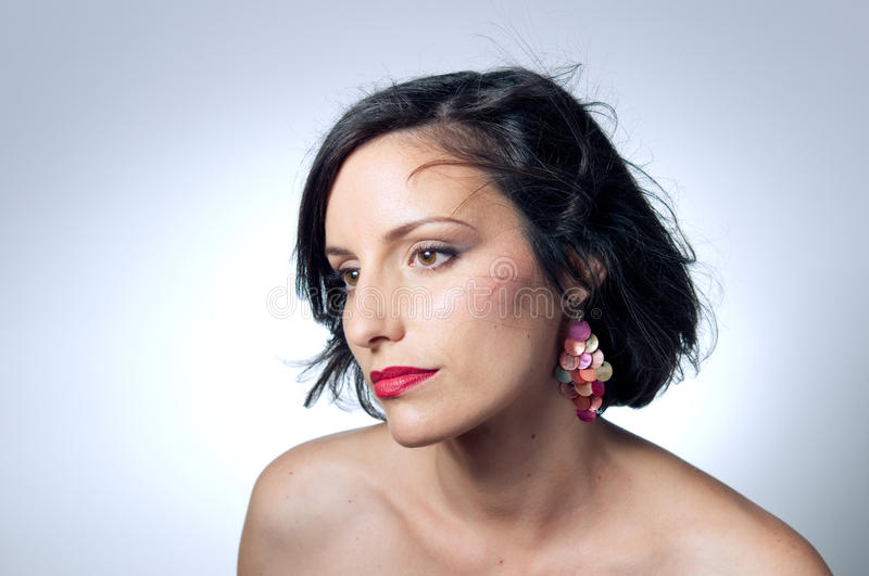 Portrait of young woman wearing earrings stock photography