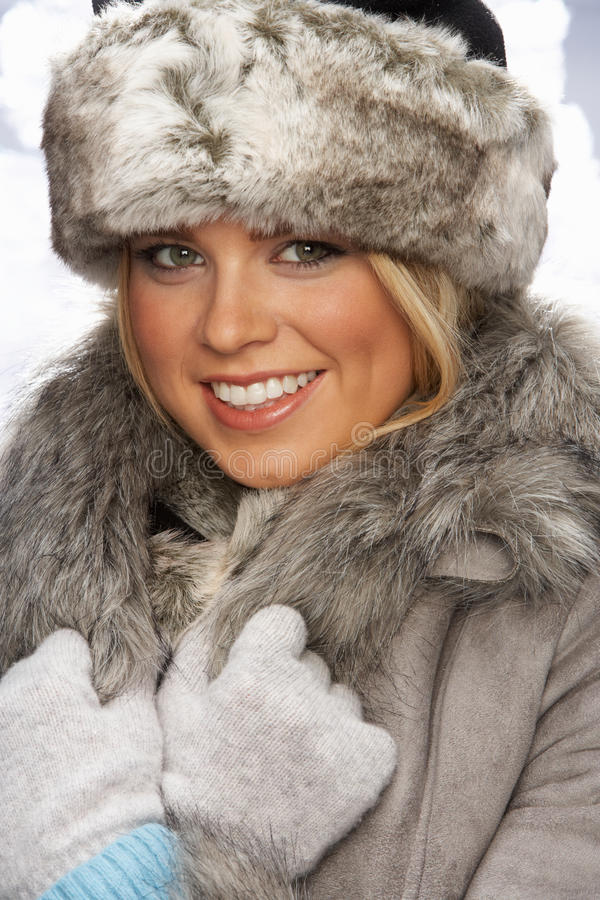 Portrait of young woman wearing fur hat and coat stock - Traumzimmer fur teenager ...