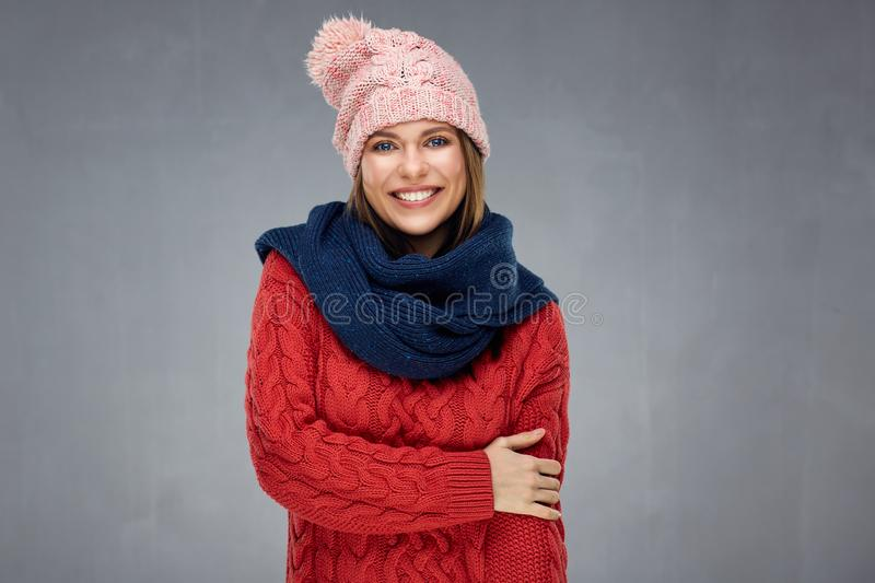 Portrait of young woman wearing scarf and winter warm knitted cl. Othes. Gray wall background stock photo