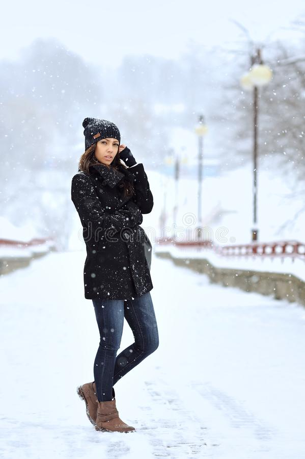 Portrait of young woman in winter park stock photography