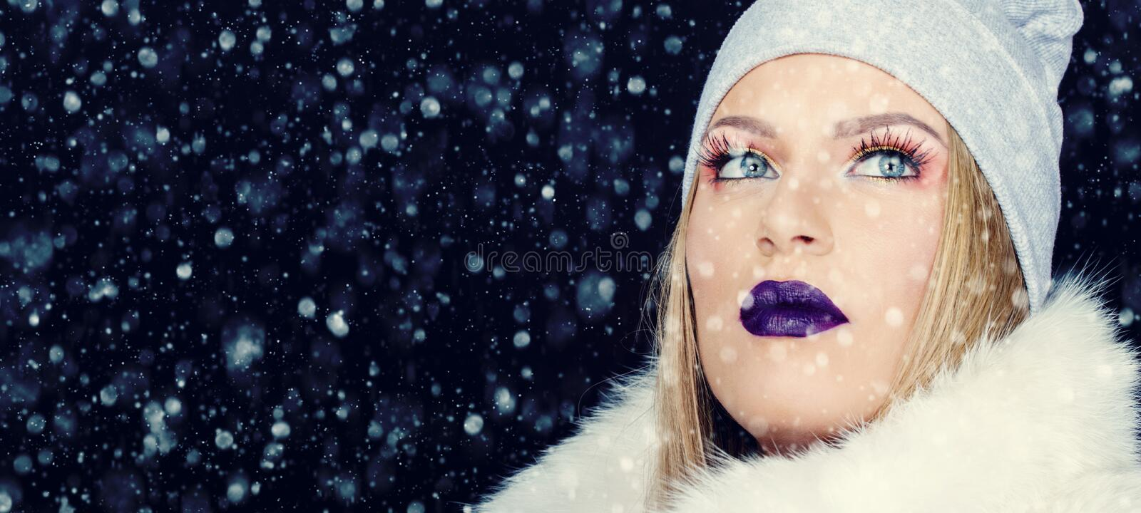 Portrait of young woman in wintertime outdoor Christmas stock photos