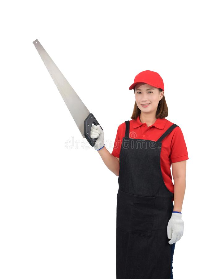 Portrait of young woman worker smiling in red uniform with apron, glove hand holding saw isolated on white backround royalty free stock photography