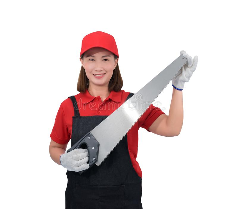 Portrait of young woman worker smiling in red uniform with apron, glove hand holding saw isolated on white backround stock photos
