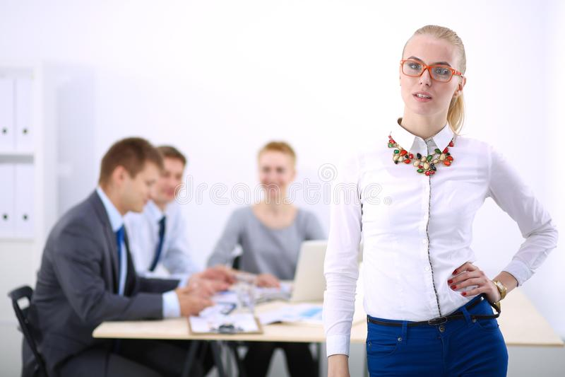 Portrait of a young woman working at office standing with folder . Portrait of a young woman. Business woman. Portrait of a young women working at office stock image