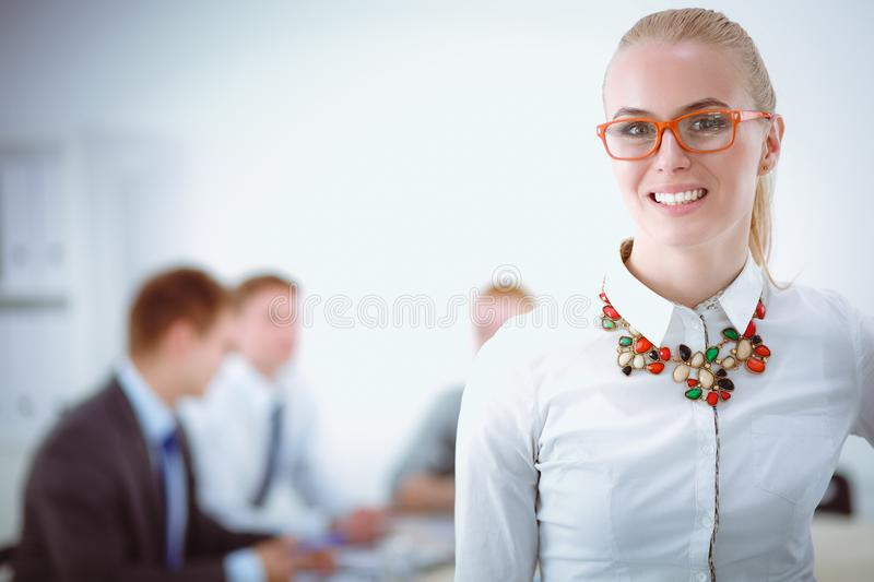 Portrait of a young woman working at office standing with folder . Portrait of a young woman. Business woman. Portrait of a young women working at office royalty free stock image