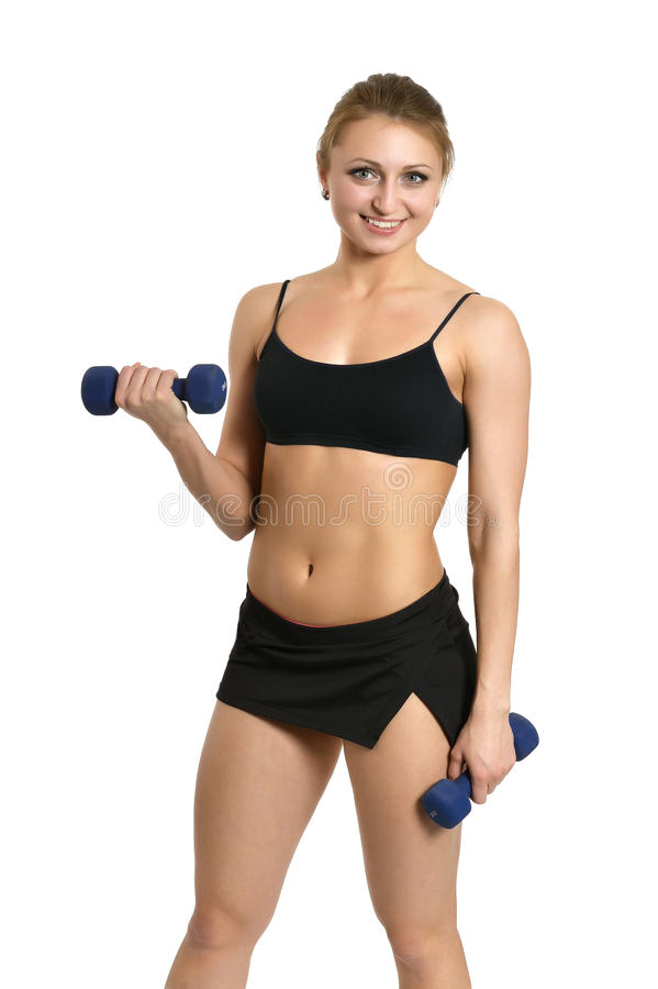 Portrait of young woman. Workout with dumbbells on white royalty free stock photo