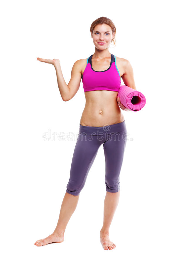 Portrait of young woman with yoga mat. stock image