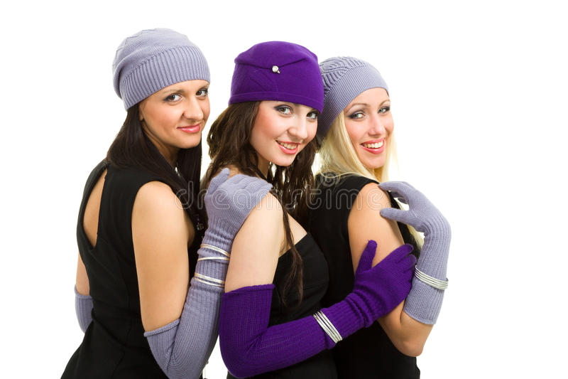 Woman in white knit wool hat and mittens. Portrait of a young women in white knit wool hat and mittens. Isolated on white background royalty free stock photography