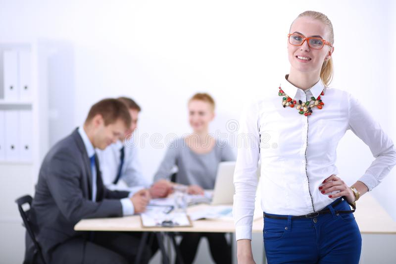 Portrait of a young woman working at office standing with folder . Portrait of a young woman. Business woman. Portrait of a young women working at office stock images