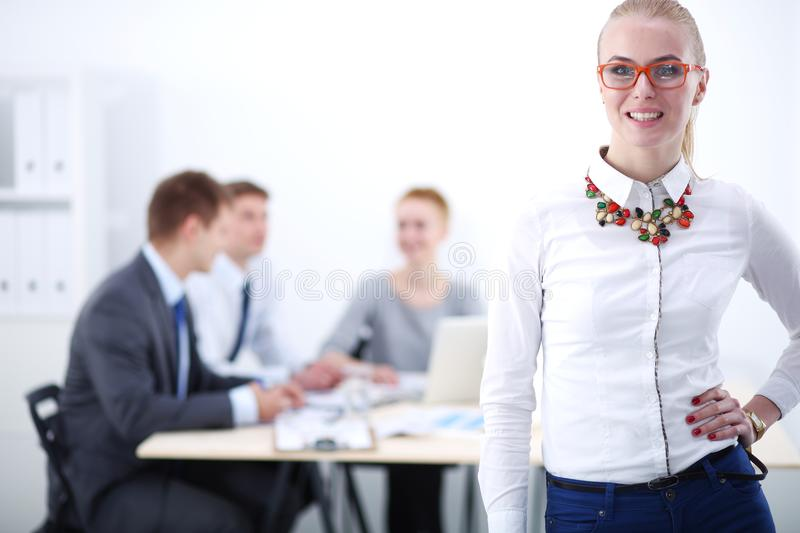 Portrait of a young woman working at office standing with folder . Portrait of a young woman. Business woman. Portrait of a young women working at office stock photography