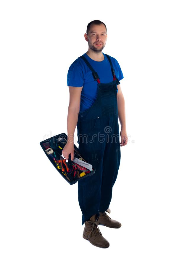 Portrait of a young worker with toolbox standing on white background royalty free stock photo