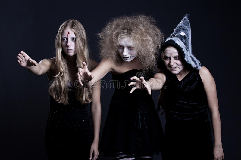 Portrait of zombie, ghost and witch. Over black background. halloween theme royalty free stock photo