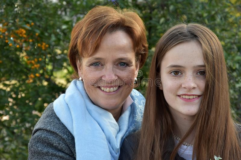 Mother and teenage daughter posing for photos royalty free stock images