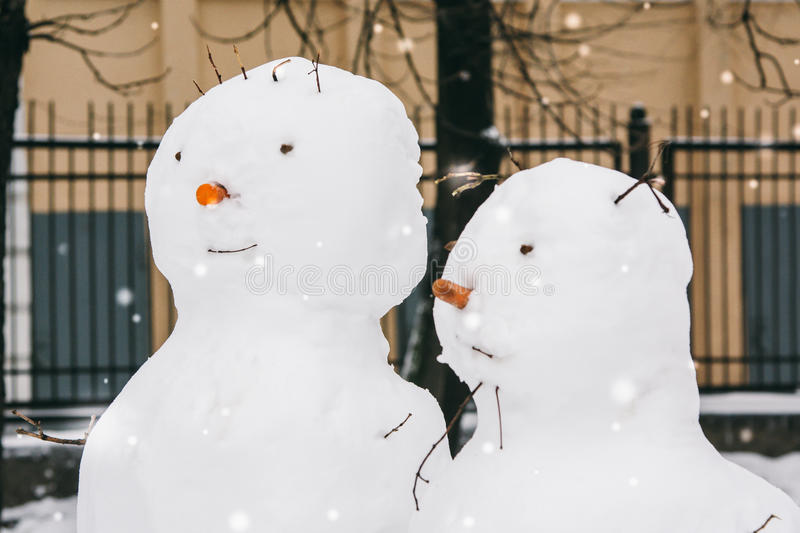 Download Portraits Of Two Snowmen In The Park Stock Photo - Image of smile, portrait: 83718838