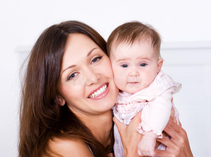 Portrat of happy mother with baby royalty free stock photos