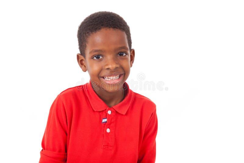 Portret śliczna amerykanin afrykańskiego pochodzenia chłopiec ono uśmiecha się, odizolowywający obrazy royalty free