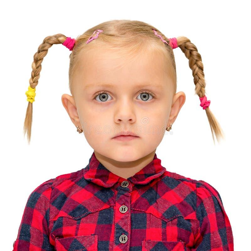 Portret śliczna młoda dziewczyna z pigtails odizolowywającymi fotografia stock