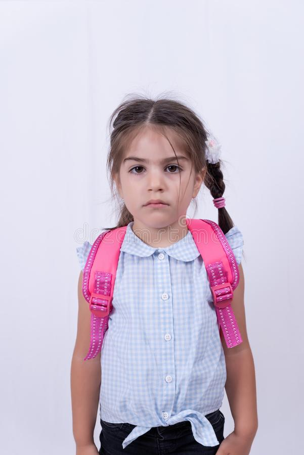 Portret śliczna nieszczęśliwa dziewczyna w mundurku szkolnym fotografia royalty free