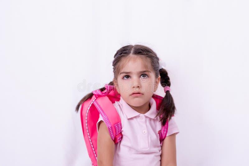 Portret śliczna nieszczęśliwa i smutna dziewczyna w mundurku szkolnym zdjęcia royalty free