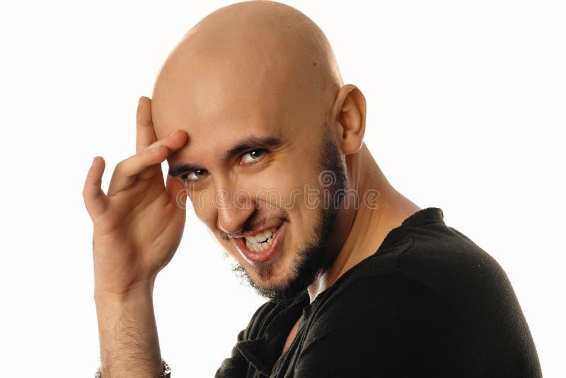Portret śmieszny młody człowiek Hamming na kamerze zdjęcie stock