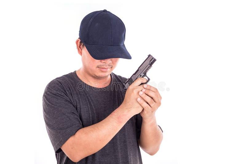 Portret Azjatycki mężczyzna mienia pistolet odizolowywający na bielu obrazy royalty free