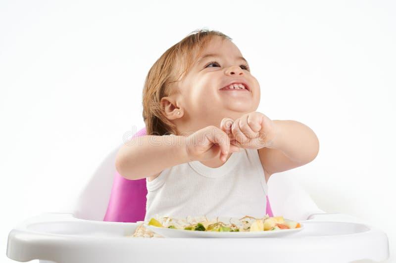 Portret bawić się z jedzeniem dziecko fotografia stock