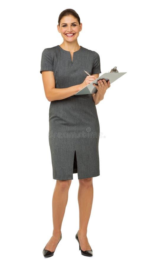 Portret bizneswomanu mienia pióro I schowek obraz stock