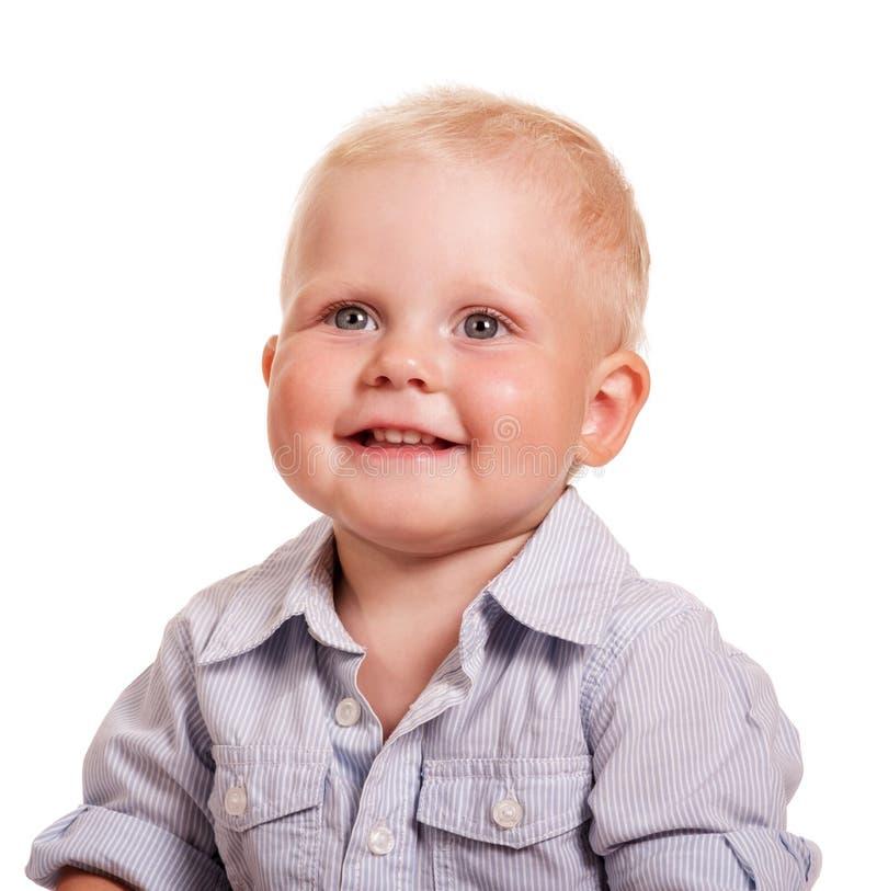 Portret chłopiec w jaskrawej pasiastej koszula odizolowywającej na bielu zdjęcia stock