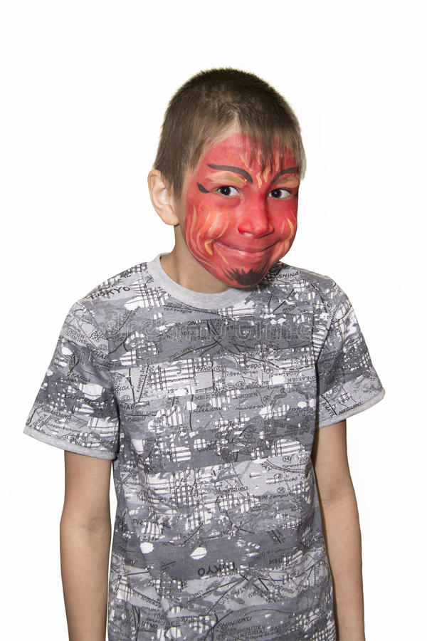 Portret chłopiec z malującą twarzą zdjęcia stock