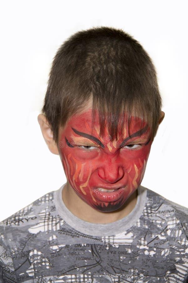 Portret chłopiec z malującą twarzą zdjęcie stock