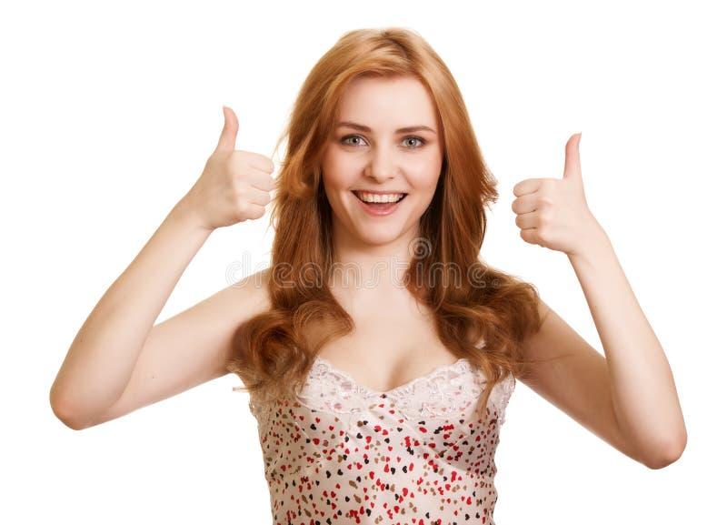 Portret dat van aantrekkelijk meisje duimen het toont ondertekent omhoog stock afbeeldingen