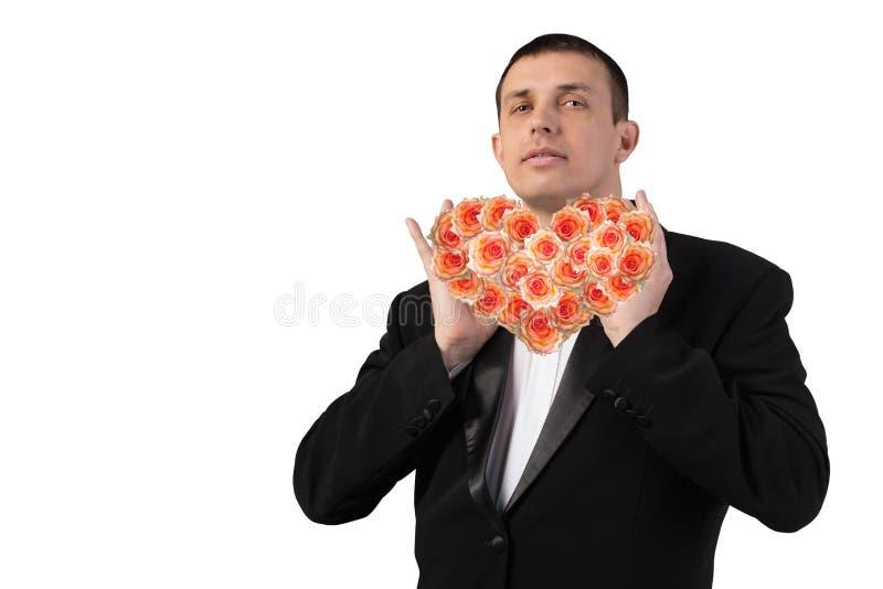 Portret de man met bloemenhart stock afbeelding