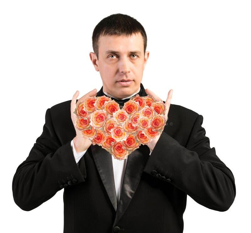 Portret de man met bloemenhart stock afbeeldingen