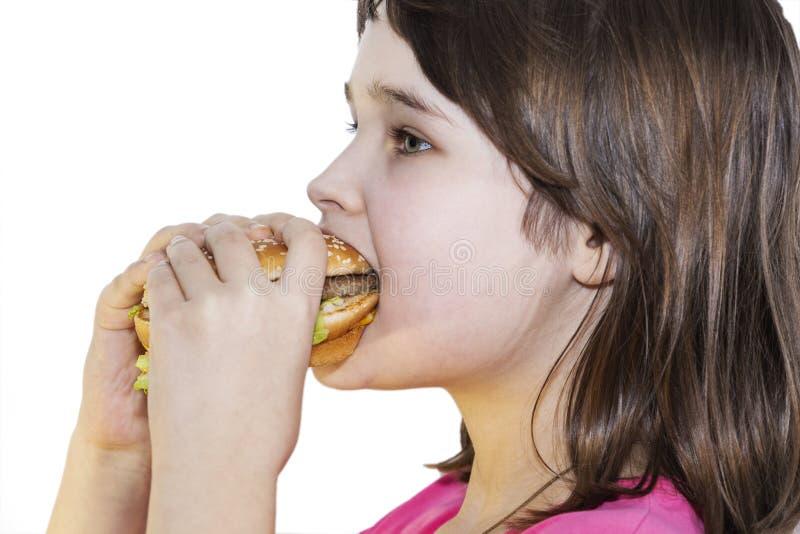 Portret dziewczyna, nastolatek i uczennica trzyma hamburger na białym tle piękni, obraz stock