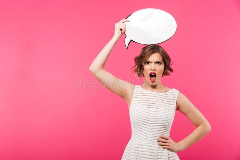 Portret gniewna dziewczyna ubierał w sukni zdjęcia stock