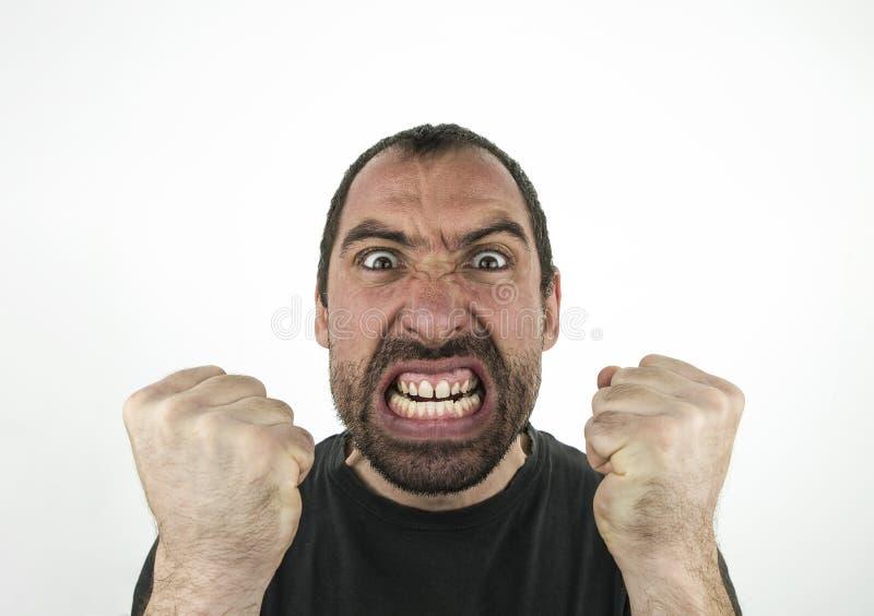 Portret gniewny niepoczytalny m??czyzna odizolowywaj?cy na bielu obrazy royalty free