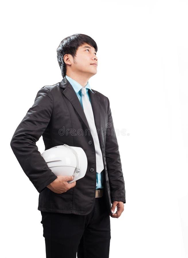 Portret inżynieria mężczyzna pozycja l i mienie zbawczy hełm zdjęcia royalty free