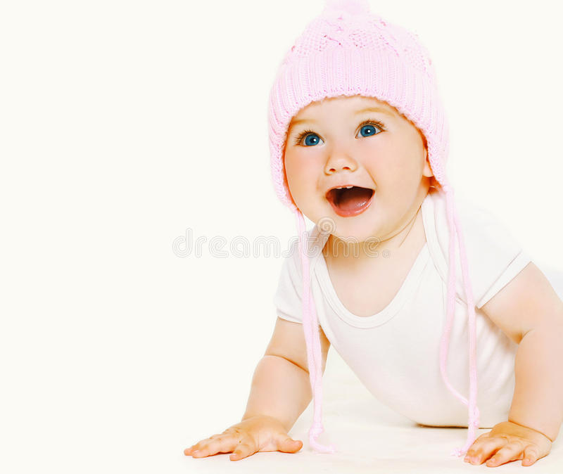 Portret lachende zoete baby in hoed stock afbeelding
