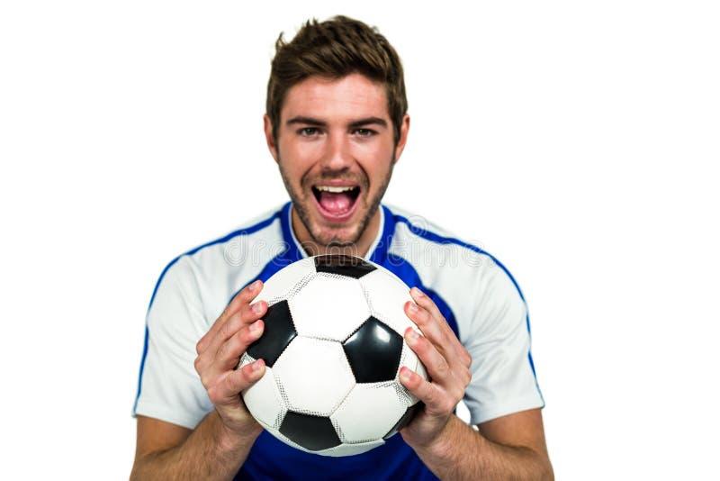 Portret mężczyzna mienia futbol z usta otwartym obrazy royalty free