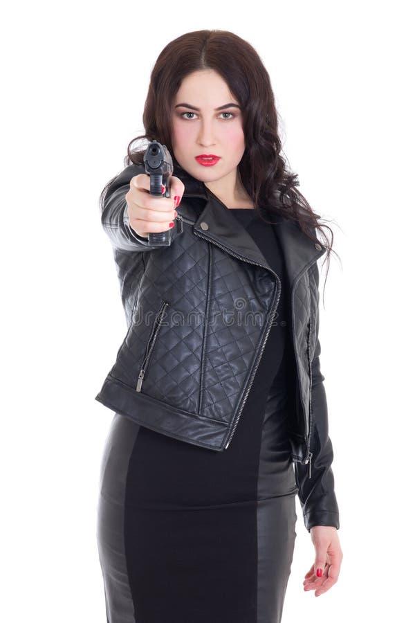 Portret młoda atrakcyjna kobieta pozuje z pistoletem odizolowywającym na w obraz royalty free