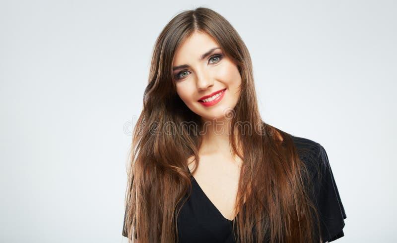 Portret młoda uśmiechnięta kobiety czerni suknia Biały tło ja fotografia stock