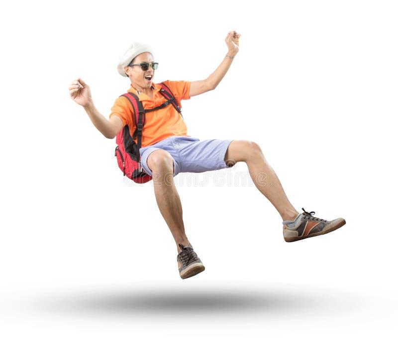 Portret młodego azjatykciego podróżnika mężczyzna spławowy w połowie powietrze z szalonym zdjęcia royalty free