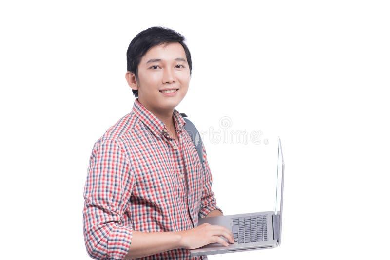 Portret młody męski azjatykci studencki mienie laptop fotografia royalty free