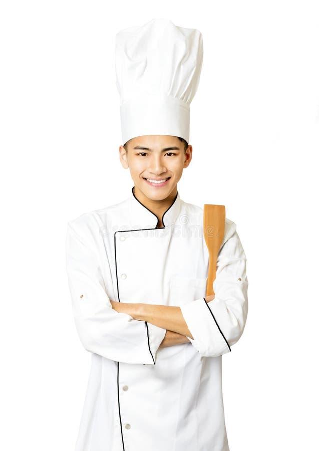 Portret młody męski szef kuchni na bielu obrazy stock