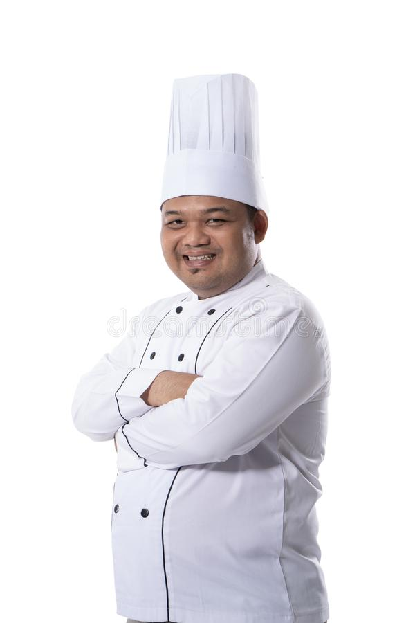 Portret młody męski szef kuchni stoi ufnego krzyżującego ręki pozy spojrzenie przy przodem kamera zdjęcie stock