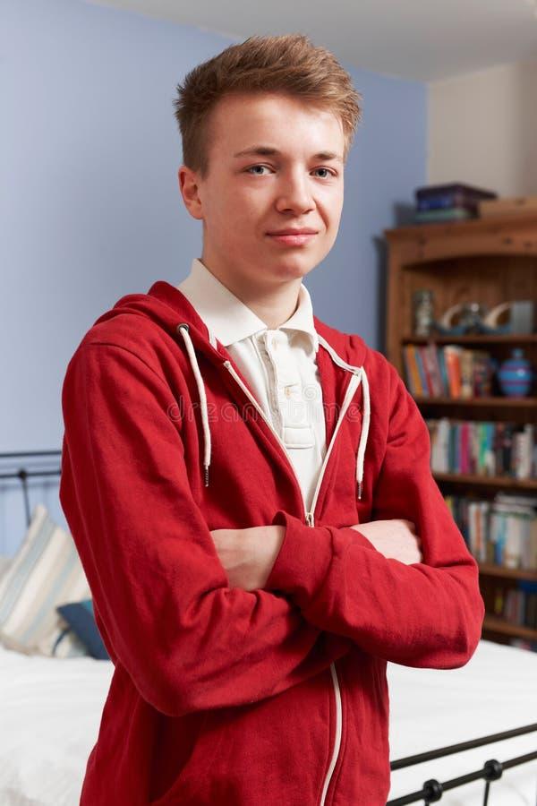 Portret nastoletni chłopak W sypialni W Domu obraz royalty free