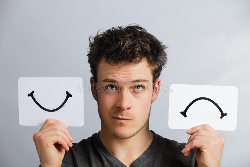 Portret osoba Trzyma Szczęśliwą i Nieszczęśliwą nastrój deskę fotografia stock